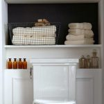 Adding built-in or freestanding shelving behind the toilet is a great way to add...