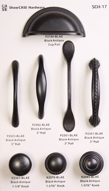 Black antiqued hardware for white mission style cabinetry. I like the third hand…