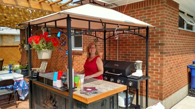 Covered the grill and the island with a cheap grill gazebo from Walmart and it l…