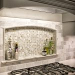 Custom Niche in Kitchen Backsplash with marble ledge.  Marble and Stone Tile bac...