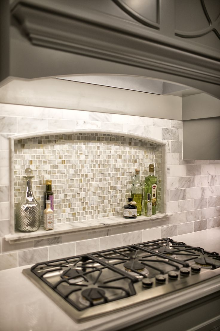Custom Niche in Kitchen Backsplash with marble ledge.  Marble and Stone Tile bac…