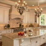 Elements of a French Country kitchen. Glazed painted cabinets. Arched window. Co...