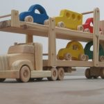Hailey the car hauler - a wooden toy truck with movable ramps - five colored cars included - green, blue, red, yellow