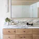 Love the veins in this marble paired with the white oak cabinetry. Green Oak Res...
