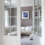 Make a pocket door like this and put photographs over glass panes for now when it's a bedroom then remove later. - My Blog