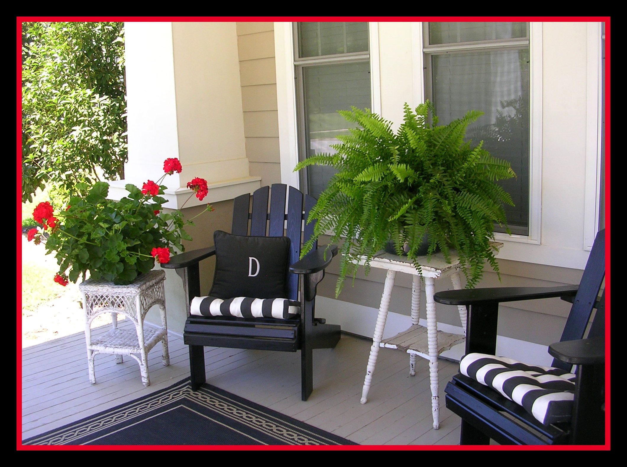 Southern porch complete with red geraniums and ferns…oh, and a big glass of sw…