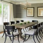 Transitional dining room features upper walls clad in gray grasscloth and lower ...