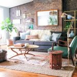 Warm toned layered rugs in bohemian living room   NONAGON.style #bohemianlivingr...