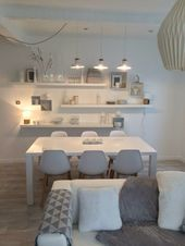 White walls but felted and soft atmosphere wooden floors designer furniture line…
