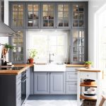 a grey kitchen with wooden countertops and whites and off whites looks tradition...