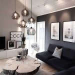 elegant interior of the living room in black and white, modern decoration of the living room ...