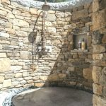 floor with lots of small gray stones, garden shower privacy, a garden with ...  ...
