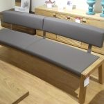 furniture-grey-fabric-bench-with-back-and-four-brown-wooden-legs-on-brown-wooden...