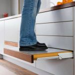 in-built step in cabinet. don't need kitchen ladder. brilliant solution!