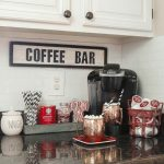 kitchen decorate white cupboard coffee machine wall decor plate container cup